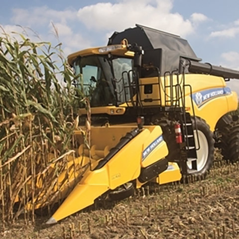 New Holland CR7090 Combine with Corn Head and Cornrower Attachment