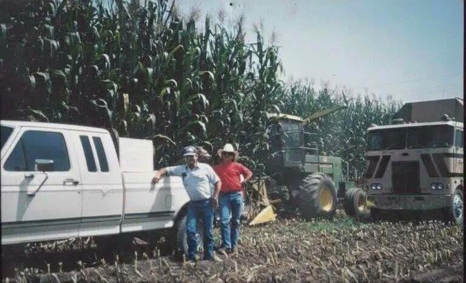 Rick and Joe Pedro in front of giant corn