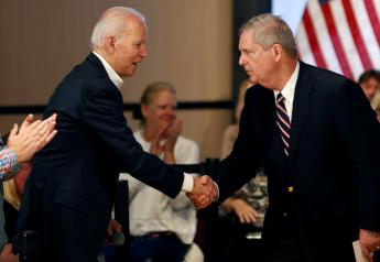 FILE PHOTO: Democratic 2020 U.S. presidential candidate and former Vice President Joe Biden shakes hands with former Iowa Governor Tom Vilsack during a campaign event in Newton, Iowa, U.S., January 30, 2020. REUTERS/Mike Segar
