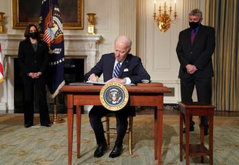 U.S. President Joe Biden signs executive order as Vice President Kamala Harris and White House science adviser Eric Lander standby in the State Dining Room at the White House in Washington, U.S., January 27, 2021. REUTERS/Kevin Lamarque