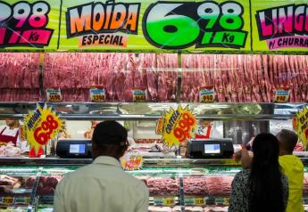 Customers buy meat from at a butchery stall inside a market in Sao Paulo, Brazil, on Saturday, March 18, 2017.