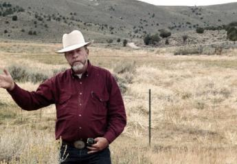 This Nov. 1997 file photo, rancher Wayne Hage, a longtime Sagebrush Rebellion figure who died in 2006, is shown in the area where federal agents seized 100 head of his cattle in 1991, in Meadow Canyon near Tonopah, Nev.