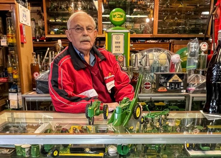 """Max Williams, surrounded by a world of toys: """"Sometimes I look around at all the toys and ask myself, 'My Lord, what have I done?'"""""""