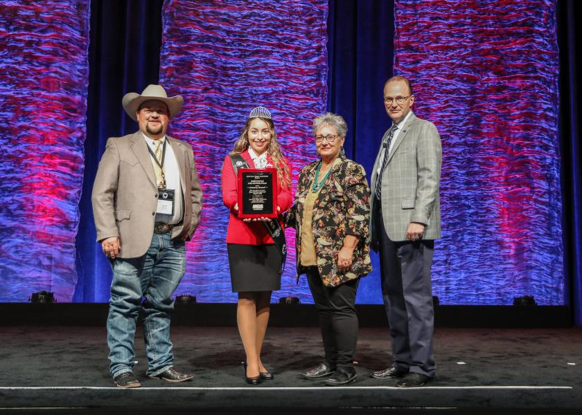 Adam Sawyer, A & B Cattle; Eva Hinrichsen, Miss American Angus, presenting; Becky Sawyer, A & B Cattle; and Mark McCully, American Angus Association CEO.