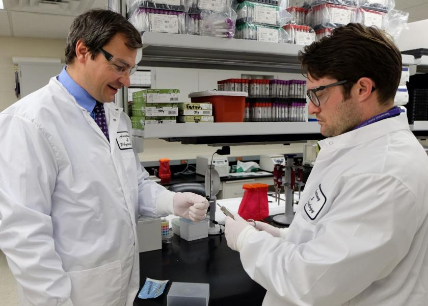 Andrew Curtis (right), doctoral research assistant works in the laboratory with Hans Coetzee (left), professor and head of the anatomy and physiology department.