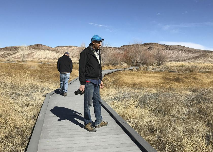 Len Warren, right, and John Zablocki from the The Nature Conservancy stand on the boardwalk at the Torrance Ranch Preserve north of Beatty, Nevada on Feb. 8, 2019.